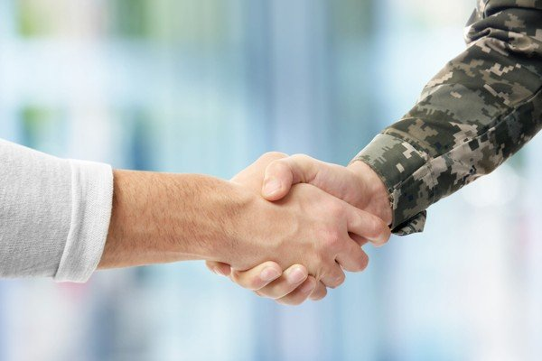 Soldier and civilian shaking hands