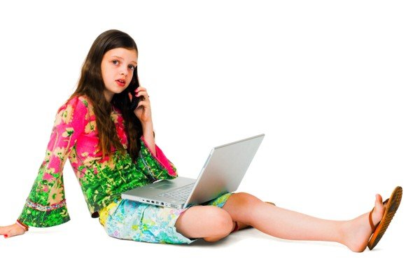 Teen With Laptop and Cell Phone