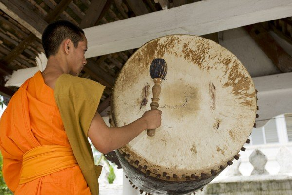 Buddhist monk with drum